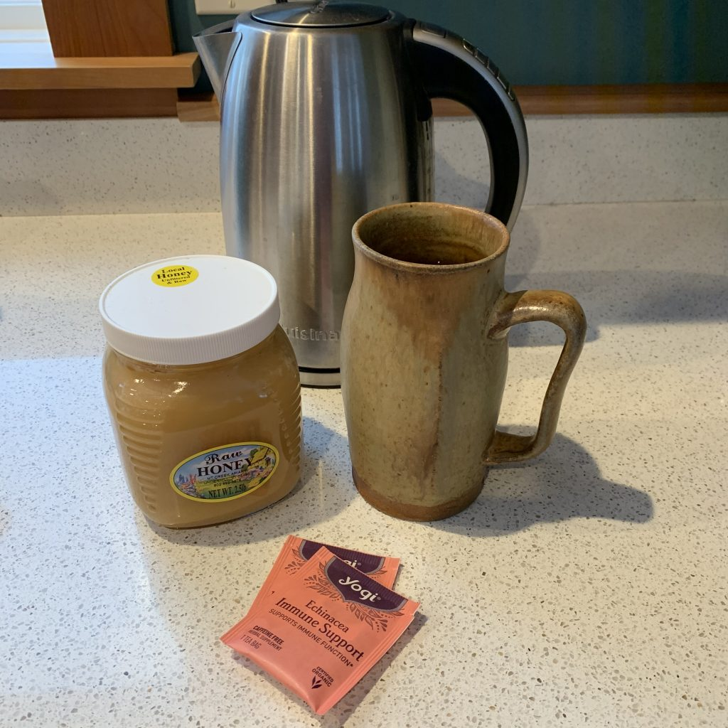 Echinacea Immune Support tea by Yogi.  Local honey unfiltered & raw by Mt. Creek Apiary.Large yellow-brown mug made by Maya Zelkin. Silver electric tea pot by Cuisinart.